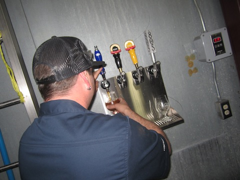 Brewer Dustin Kral at the DBA tap