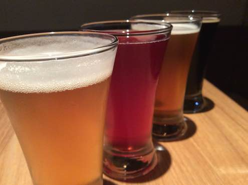 A flight of Ballast Point at Plan Check