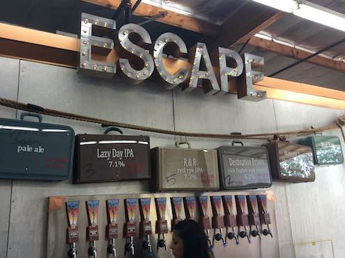 Cool luggage beer board at Escape.